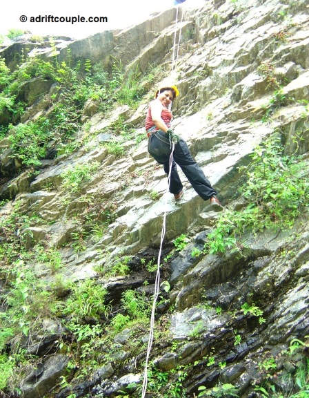 Rappelling on a natural rock face at Park Woods Shoghi.