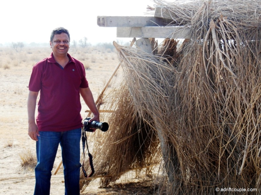 Achal at the cramped straw shelter in DNP, Jaisalmer
