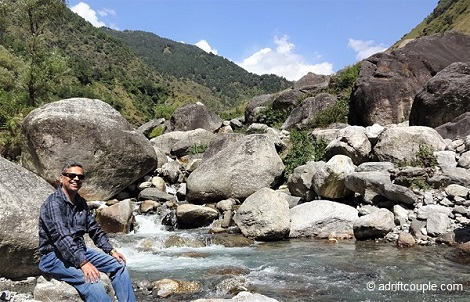 Enveloped by extreme peace sitting on a rock by the Gunehar river.
